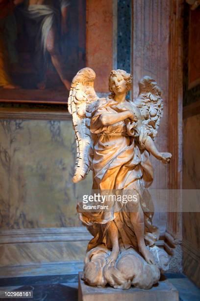 Carved angel in light.