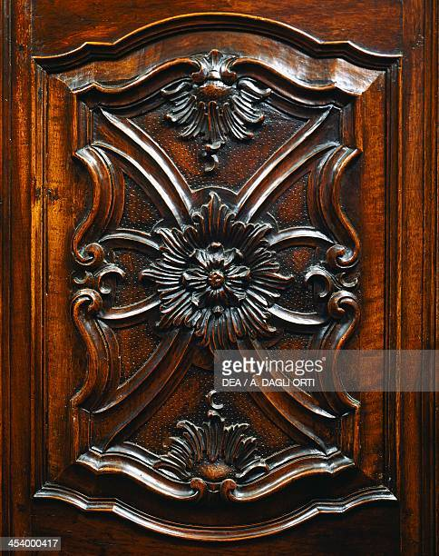 Carved door detail from a carved walnut wardrobe with the coat of arms of the Counts of Cavour Turin 1729 Italy 18th century