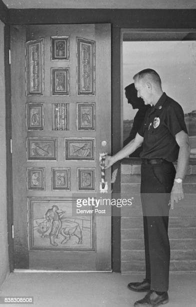 Carved Door Is One Of Station's Feature Lt M D Ketchum of Aurora Fire Department examines it Credit Denver Post