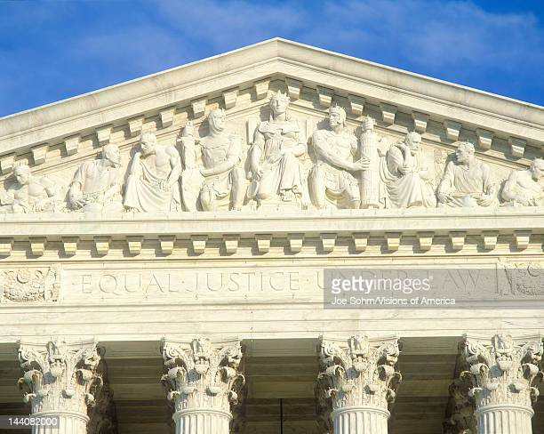 Carved figures in pediment of the United States Supreme Court Building Washington DC