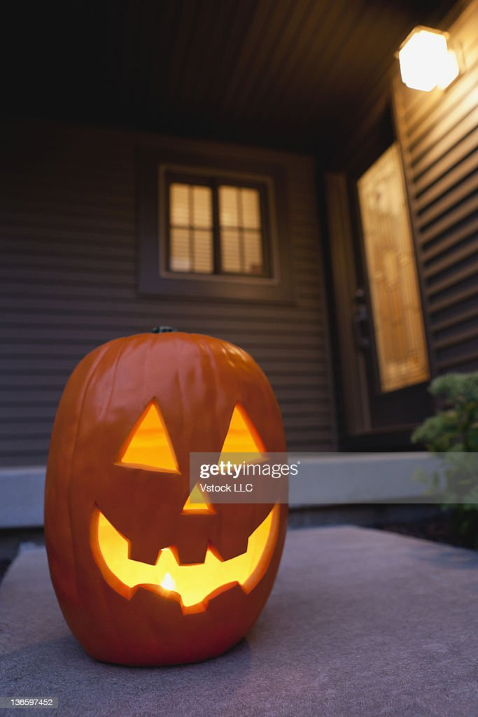 Carved jack-o-lantern in front of house