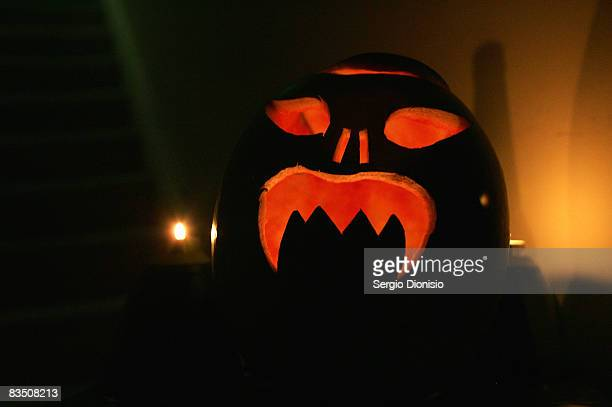 A carved pumpkin is seen alight at a Halloween house party on October 31 2008 in Sydney Australia Halloween also known as Hallowe'en and shortened...