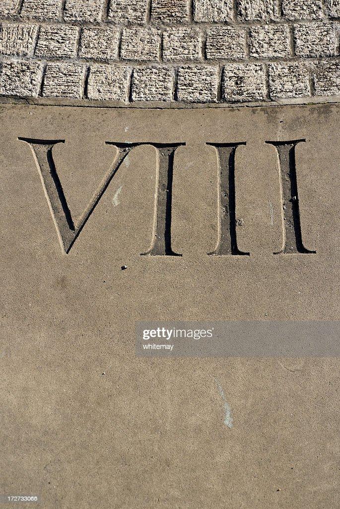 Carved Roman numeral VIII on sundial
