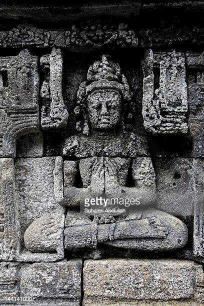 A carved stone relief sits on the lower terraces of Borobudur temple on April 8 2012 in Java Indonesia Borobudur the famous Buddhist temple is listed...