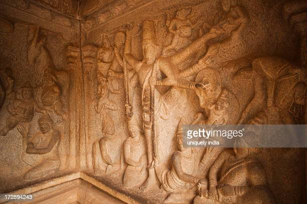 Carving details of Trivikrama the Vamana avatar of Vishnu with one leg on the earth and the other on the skie at Varaha Cave Temple, Mahabalipuram, Kanchipuram District, Tamil Nadu, India