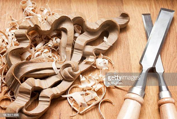 Carving utensils and carved wood on wooden floor