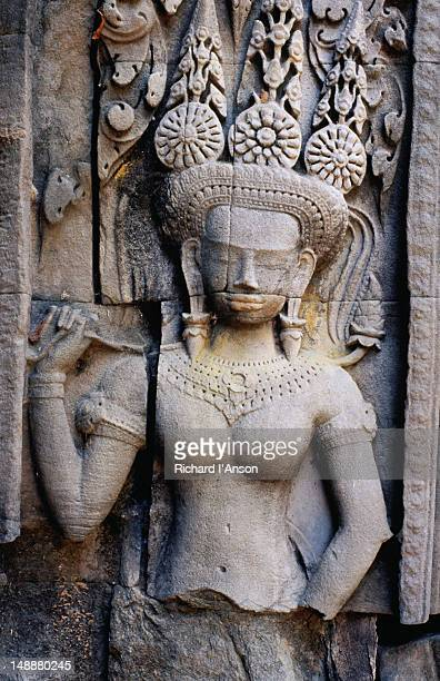 Carvings of aspara (heavenly nymphs) decorate the Thommanon temple dedicated to the Hindu gods Shiva and Vishnu.