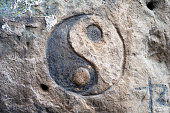 Bubnyshche between the rocks - an ancient pagan temple, where tourists stop modern travelers and hippies left in their memory patterns on the stones on their faith and religion, yin and yang