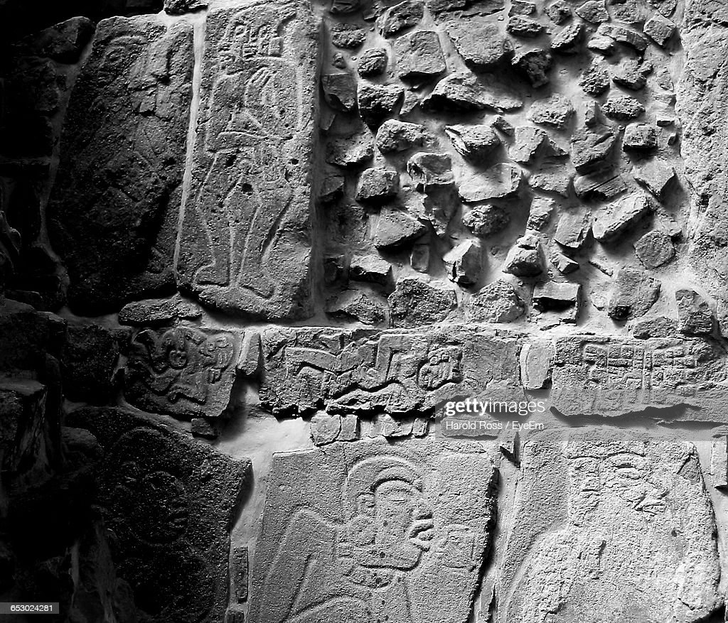 Carvings on stone wall stock foto getty images