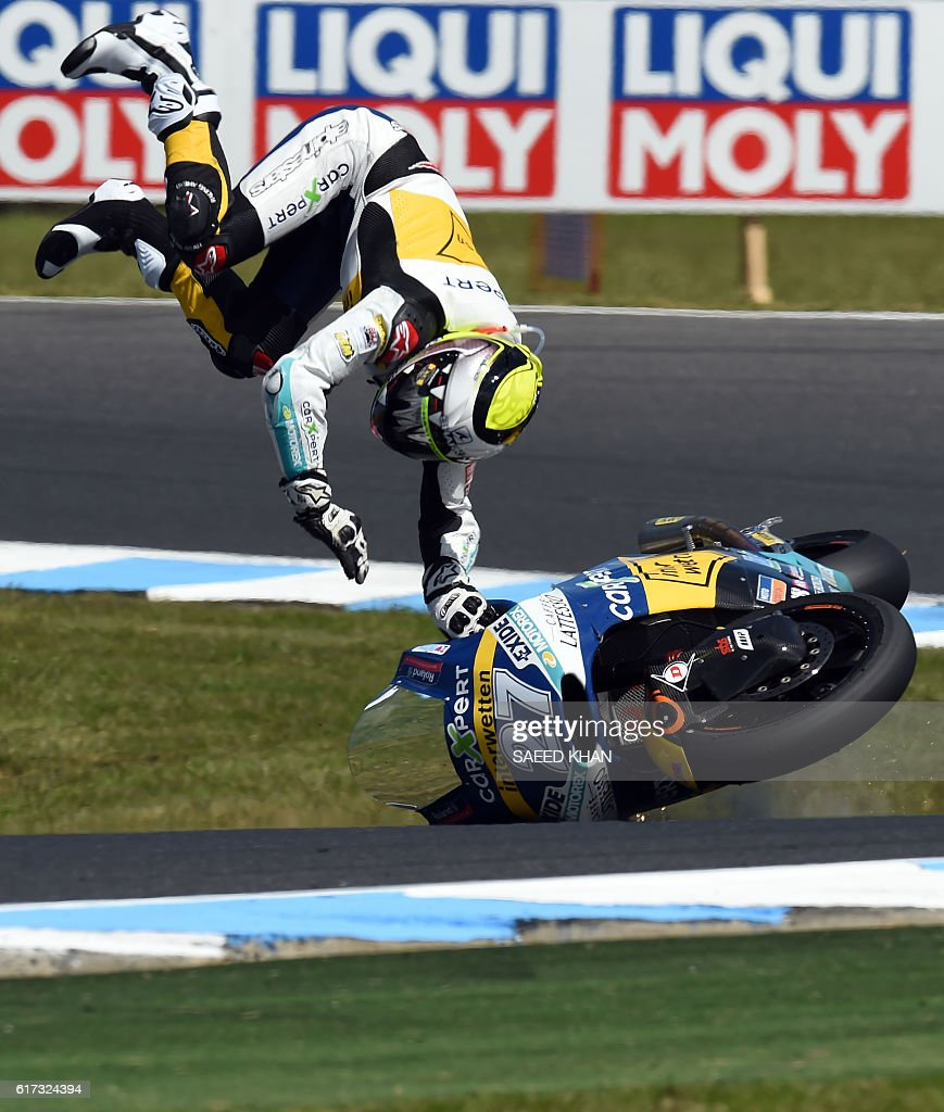 CarXpert Interwetten's Spanish rider Iker Lecuona crashes during the Australian Moto2 race at Phillip Island on October 23, 2016. / AFP / SAEED