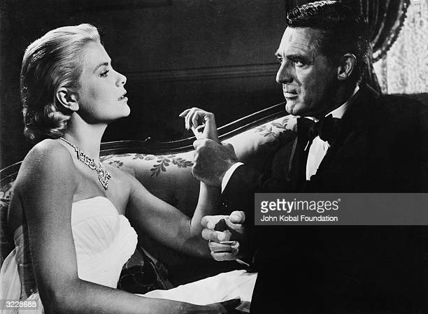 Cary Grant and Grace Kelly star in the Alfred Hitchcock thriller 'To Catch A Thief' Grant plays John Robie a former jewel thief who must clear his...