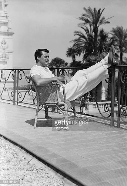 Cary Grant film idol is snapped as he recently appeared in the gardens of the Hotel de Paris where he stopped on his vacation tour which will carry...