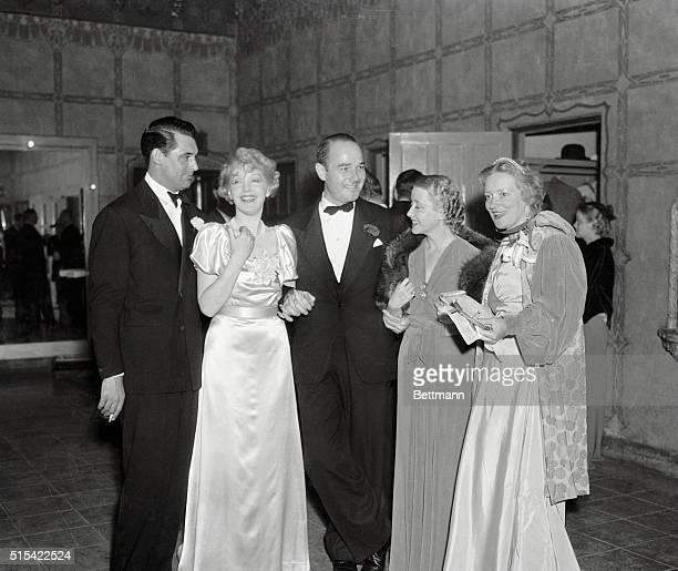 Cary Grant Ina Claire William Haines Genevieve Tobin Poggy Wood backstage at a LA theater after her recent opening there Miss Claire is seen to...