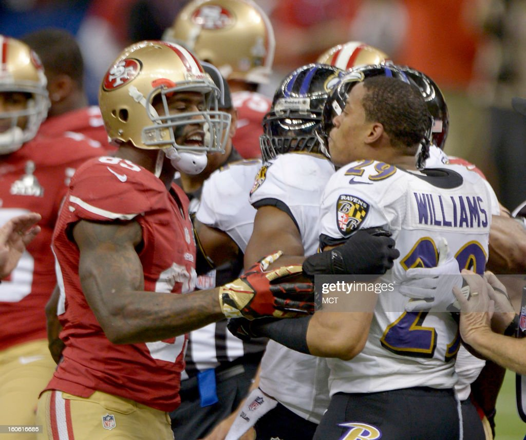 Cary Williams (29) of the Baltimore Ravens and Vernon Davis (85) reacts to San Francisco 49ers during first-half action in Super Bowl XLVII at the Mercedes-Benz Superdome in New Orleans, Louisiana, Sunday, February 3, 2013.
