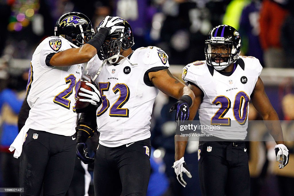 Cary Williams #29 of the Baltimore Ravens celebrates with Ray Lewis #52 after intercepting a pass by Tom Brady #12 of the New England Patriots in the fourth quarter during the 2013 AFC Championship game at Gillette Stadium on January 20, 2013 in Foxboro, Massachusetts.