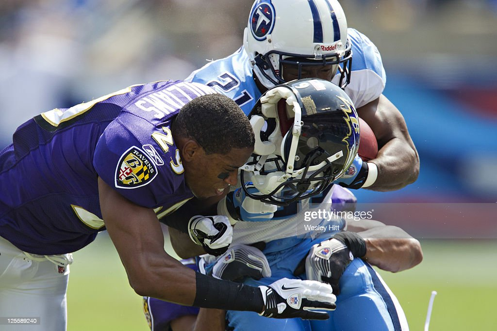 Cary Williams of the Baltimore Ravens loses his helmet while making a hit on Javon Ringer of the Tennessee Titans at the LP Field on September 18...