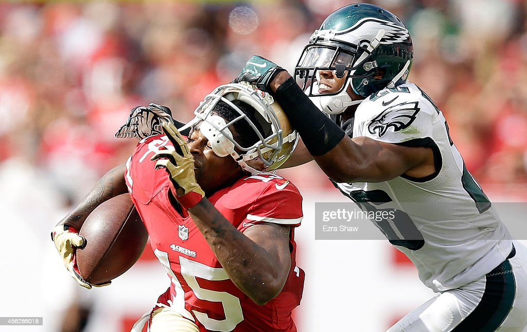 Cary Williams #26 of the Philadelphia Eagles pulls the helmet off of <a gi-track='captionPersonalityLinkClicked' href=/galleries/search?phrase=Michael+Crabtree&family=editorial&specificpeople=4650635 ng-click='$event.stopPropagation()'>Michael Crabtree</a> #15 of the San Francisco 49ers during the second quarter at Levi's Stadium on September 28, 2014 in Santa Clara, California.