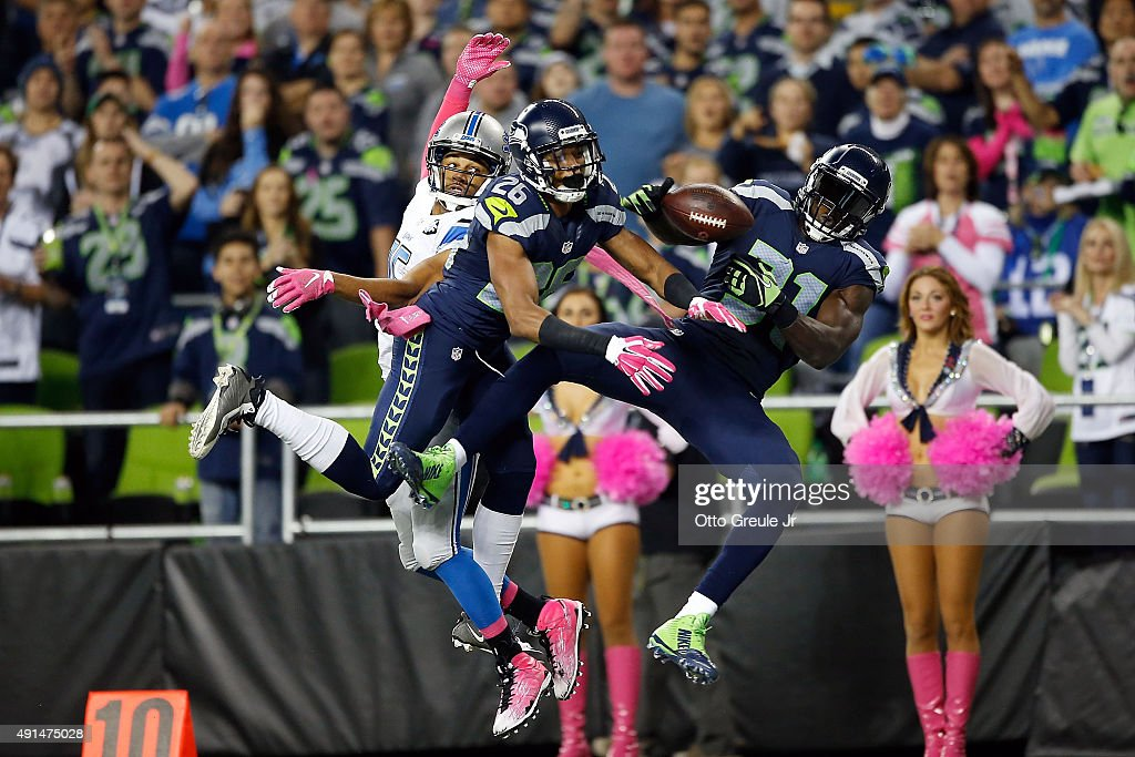 <a gi-track='captionPersonalityLinkClicked' href=/galleries/search?phrase=Cary+Williams+-+American+Football+Player&family=editorial&specificpeople=10178470 ng-click='$event.stopPropagation()'>Cary Williams</a> #26 of the Seattle Seahawks and <a gi-track='captionPersonalityLinkClicked' href=/galleries/search?phrase=Kam+Chancellor&family=editorial&specificpeople=4489525 ng-click='$event.stopPropagation()'>Kam Chancellor</a> #31 of the Seattle Seahawks defend a pass intended for <a gi-track='captionPersonalityLinkClicked' href=/galleries/search?phrase=Golden+Tate&family=editorial&specificpeople=4500989 ng-click='$event.stopPropagation()'>Golden Tate</a> #15 of the Detroit Lions during the second half of their game at CenturyLink Field on October 5, 2015 in Seattle, Washington.