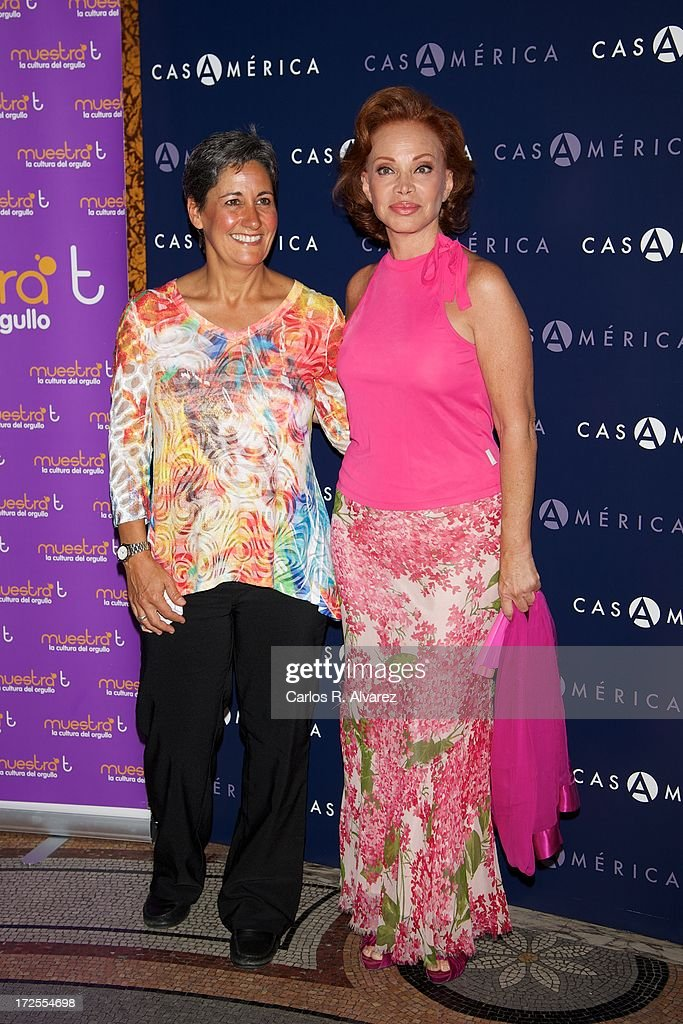 Caryl Dolinko (L) and Spanish singer Paloma San Basilio (R) receive the 'Muestra-T' 2013 award at the Casa America on July 3, 2013 in Madrid, Spain.