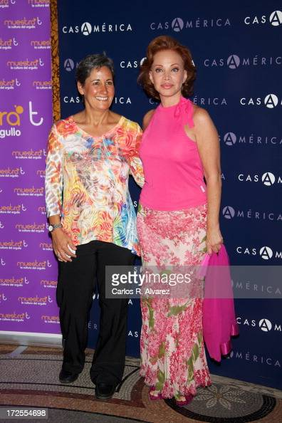 Caryl Dolinko and Spanish singer Paloma San Basilio receive the 'MuestraT' 2013 award at the Casa America on July 3 2013 in Madrid Spain