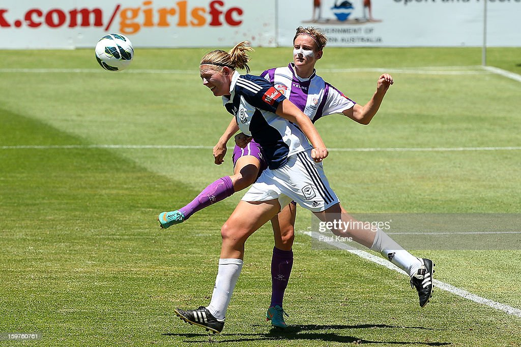 Carys Hawkins of the Glory and Maika Ruyter-Hooley of the Victory contest for the ball during the W-League Semi Final match between Perth Glory and Melbourne Victory at nib Stadium on January 20, 2013 in Perth, Australia.
