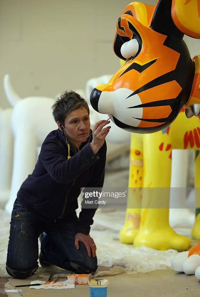 Carys Tait paints one of the Gromit sculptures, of around 70, some of which have been painted by celebrity artists, including, Cath Kidston and Richard Williams, before they are placed around the city for public view as part of charity initiative arts trail, on April 19, 2013 in Bristol, England. After being displayed to the public from July 1, the sculptures will be eventually auctioned off to raise funds for the Bristol Children's Hospital charity, Wallace & Gromit's Grand Appeal.