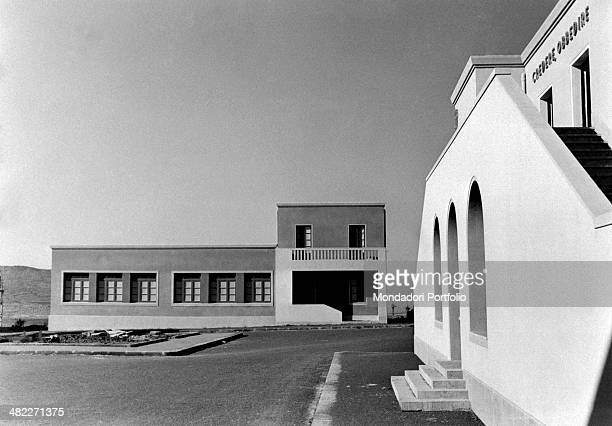 Casa del Fascio and school building in the central square of Borgo Rizza during the area regeneration sponsored by the Ente di Colonizzazione del...