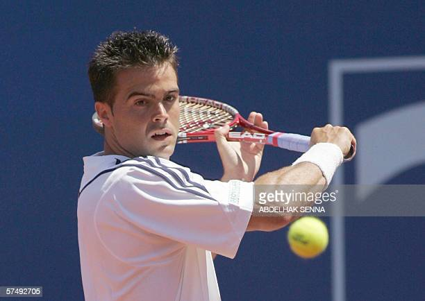 Italian Daniele Bracciali returns the ball to French Gilles during a semi final match 29 April 2006 in Casablanca AFP PHOTO/ABDELHAK SENNA