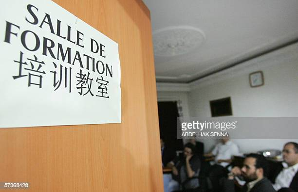 Moroccain businessmen sit in a classroom 19 April 2006 where they are taught chinese in Casablanca in a bid to increase the prospect of successfully...