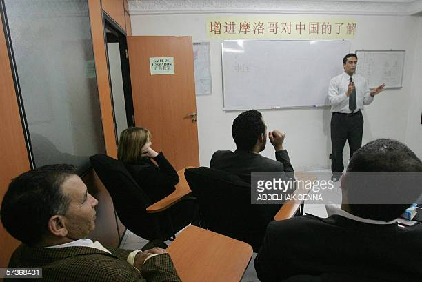 Moroccain businessmen sit in a classroom 19 April 2006 at the moroccainchinese research centre in Casablanca where they are taught chinese in in a...