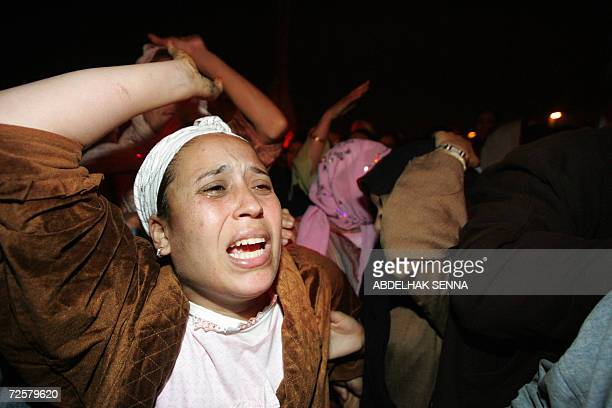 Residents of the Sidi Moumene slum in Casablanca follow 16 November 2006 the hearse carrying the body of radical Moroccan Islamist leader Zakaria...