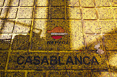 A Casablanca name sign sits on yellow decking beneath a company logo on the Casablanca oil platform operated by Repsol SA in the Mediterranean Sea...