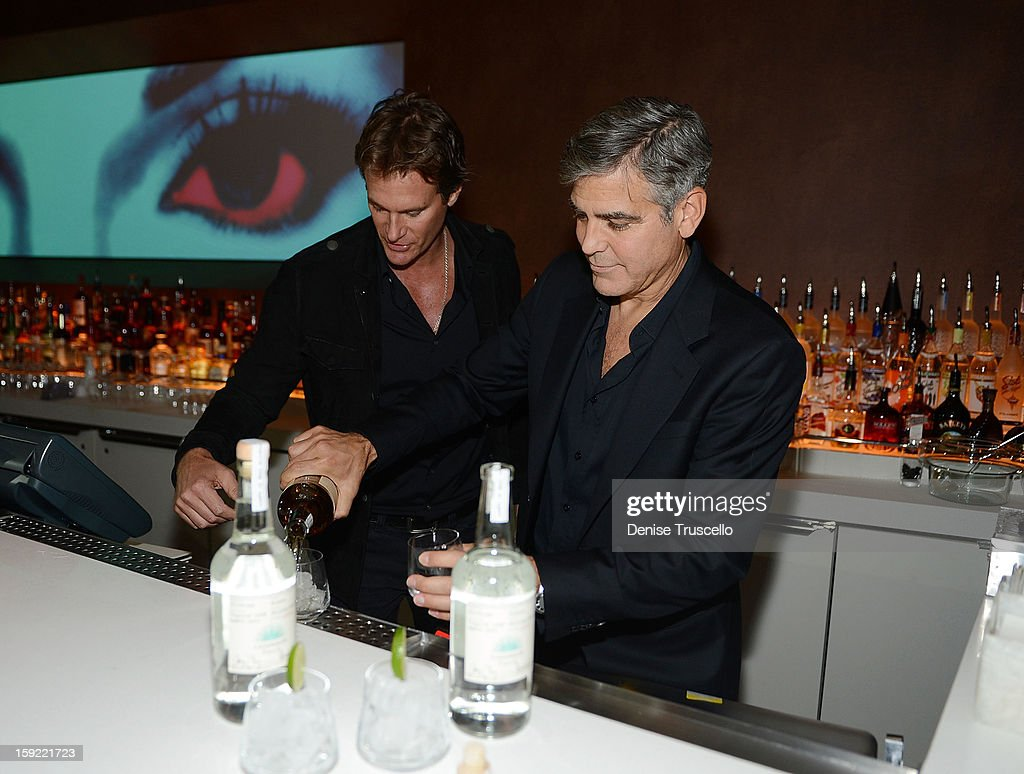 Casamigos Tequila founders <a gi-track='captionPersonalityLinkClicked' href=/galleries/search?phrase=Rande+Gerber&family=editorial&specificpeople=549565 ng-click='$event.stopPropagation()'>Rande Gerber</a> and <a gi-track='captionPersonalityLinkClicked' href=/galleries/search?phrase=George+Clooney&family=editorial&specificpeople=202529 ng-click='$event.stopPropagation()'>George Clooney</a> celebrate the launch of Casamigos at Andrea's at Encore Las Vegas on January 9, 2013 in Las Vegas, Nevada.