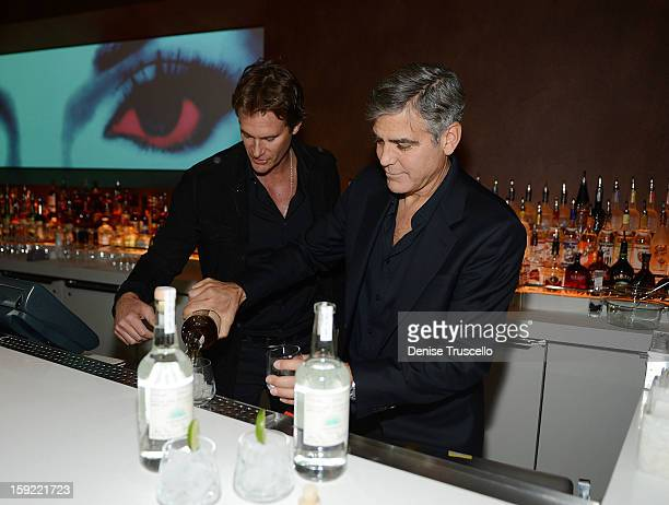 Casamigos Tequila founders Rande Gerber and George Clooney celebrate the launch of Casamigos at Andrea's at Encore Las Vegas on January 9 2013 in Las...