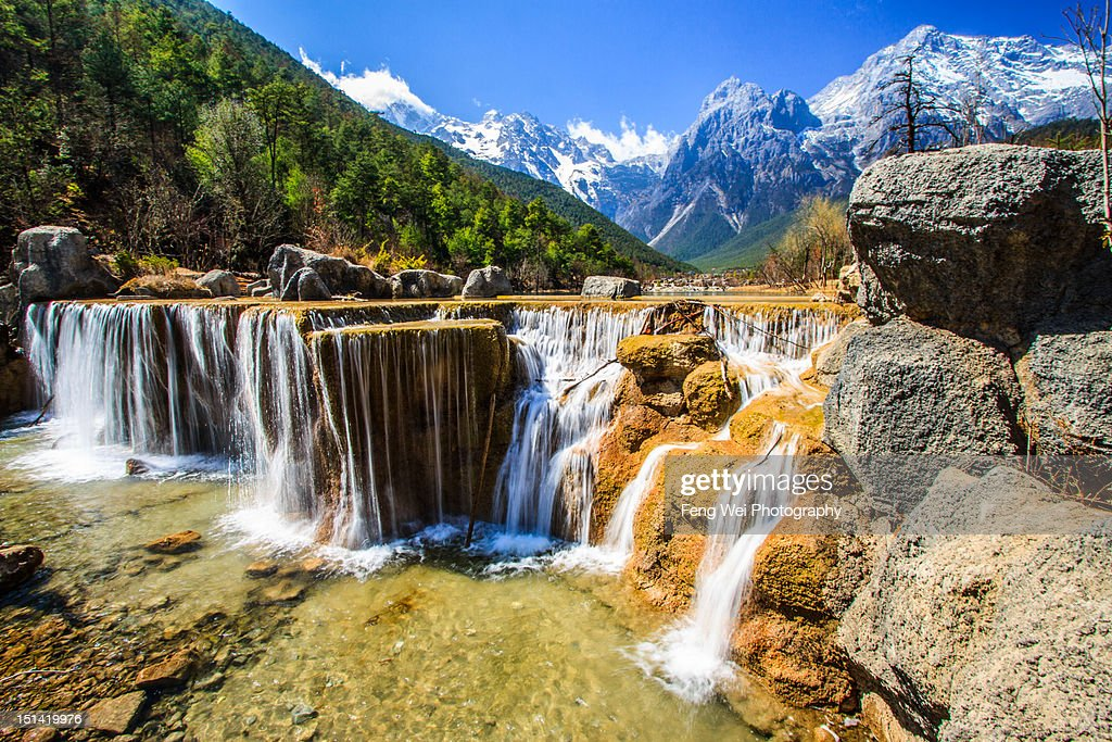 Cascaded waterfall and Jade Dragon Snow Mountain