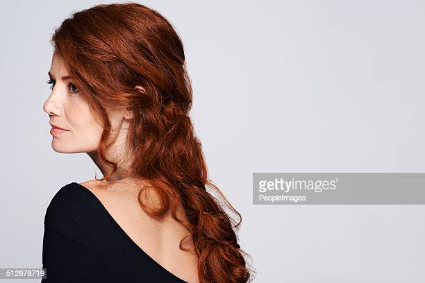Cascading curls down her back
