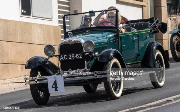 Cascais Classic Motor Show participants drive a classic Ford on Avenida Marginal on September 17 2017 in Estoril Portugal More than 1000 vehicles...