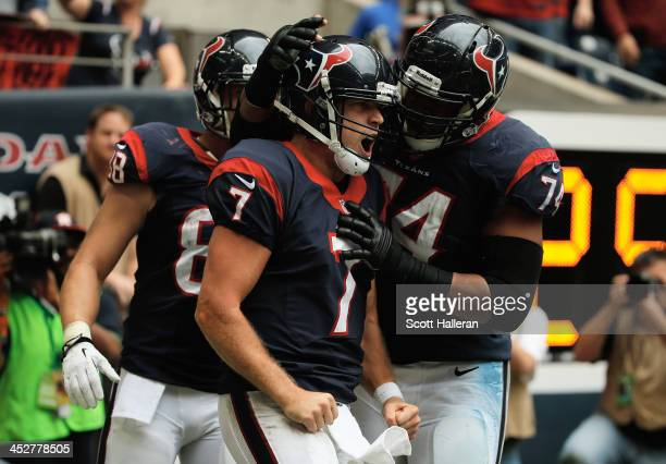 Case Keenum of Houston Texans celebrates after running for a five yard touchdown in the third quarter during the game against the New England...