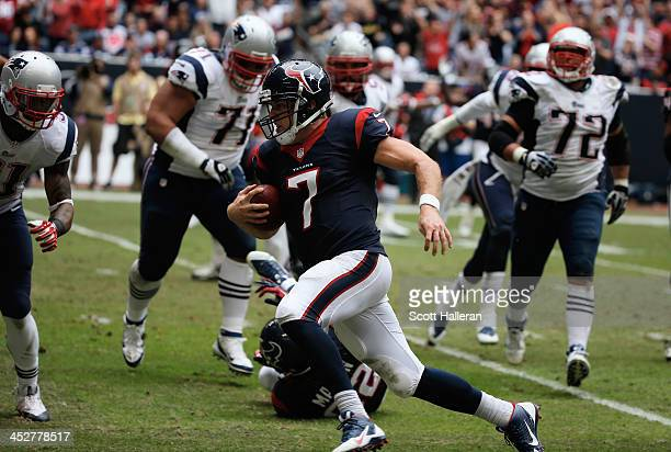 Case Keenum of Houston Texans runs for a five yard touchdown in the third quarter during the game against the New England Patriots at Reliant Stadium...