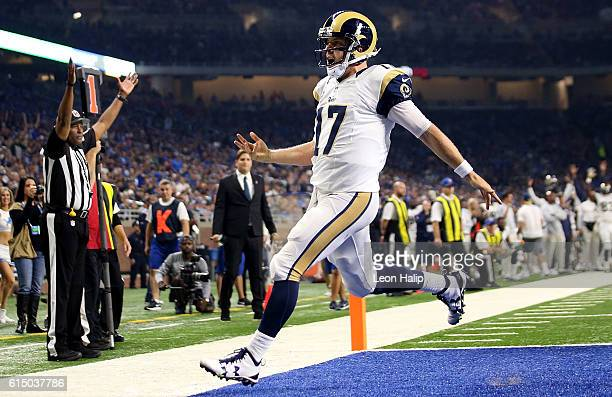 Case Keenum of the Los Angeles Rams celebrates after scoring a touchdown against the Detroit Lions during first half action at Ford Field on October...