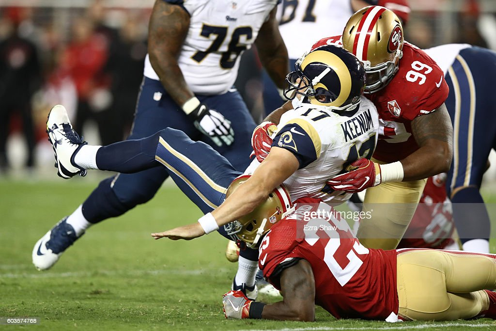 Case Keenum #17 of the Los Angeles Rams is tackled by Jimmie Ward #25 and DeForest Buckner #99 of the San Francisco 49ers during their NFL game at Levi's Stadium on September 12, 2016 in Santa Clara, California.