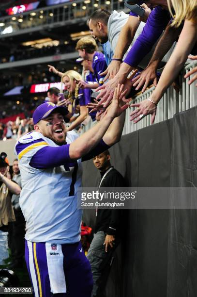 Case Keenum of the Minnesota Vikings celebrates with fans after beating the Atlanta Falcons at MercedesBenz Stadium on December 3 2017 in Atlanta...