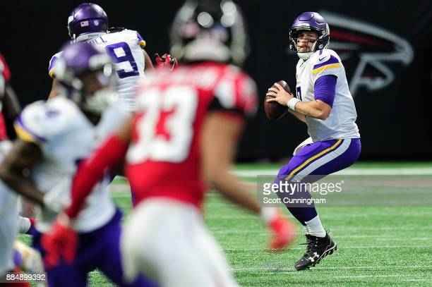 Case Keenum of the Minnesota Vikings drops back to pass during the first half against the Atlanta Falcons at MercedesBenz Stadium on December 3 2017...