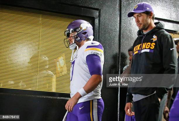 Case Keenum of the Minnesota Vikings heads to the field with Sam Bradford before the start of the game against the Pittsburgh Steelers at Heinz Field...