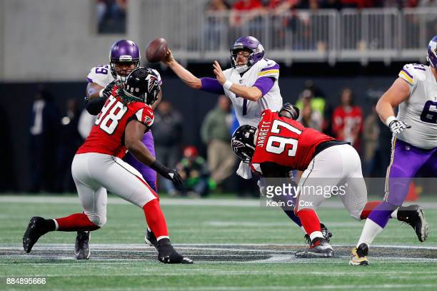 Case Keenum of the Minnesota Vikings is sacked by Grady Jarrett of the Atlanta Falcons during the first half at MercedesBenz Stadium on December 3...