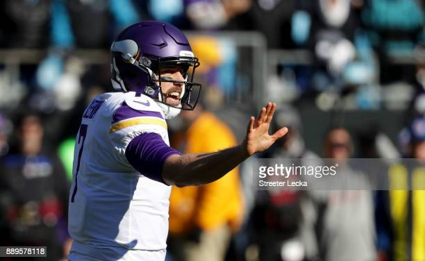 Case Keenum of the Minnesota Vikings makes a call at the line against the Carolina Panthers in the first quarter during their game at Bank of America...