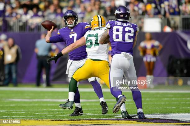 Case Keenum of the Minnesota Vikings passes the ball under pressure from Kyler Fackrell of the Green Bay Packers during the game on October 15 2017...
