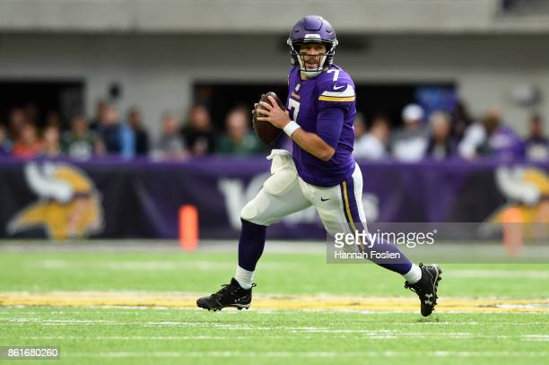 Case Keenum of the Minnesota Vikings runs out of the pocket during the second quarter of the game against the Greenbay Packers on October 15 2017 at...