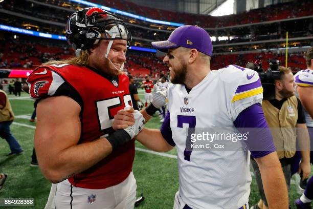 Case Keenum of the Minnesota Vikings shakes hands with Brooks Reed of the Atlanta Falcons after winning the game at MercedesBenz Stadium on December...