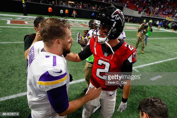 Case Keenum of the Minnesota Vikings shakes hands with Matt Ryan of the Atlanta Falcons after the game at MercedesBenz Stadium on December 3 2017 in...